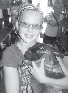 Chelsey Raabe, Pettisville, with her American sable bunny,