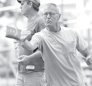 Lenny Miller, Archbold, has an intense look on his face as he throws the bag in the cornhole tournament.– photo by Mary Huber
