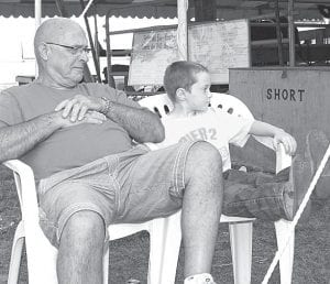 Al Nofziger, Pettisville, and his neighbor (and adopted grandson) Hunter Eby, a kindergartner at Pettisville, chill out.– photo by Mary Huber