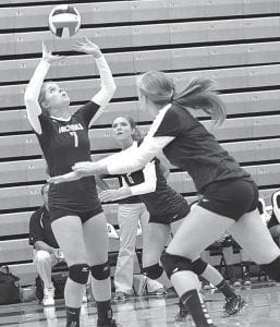 Cassidy Williams (7) sets the ball for a Blue Streak attack.– photo by Mario Gomez