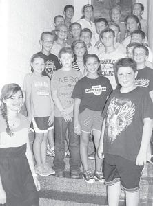 Rahel Frei, bottom left, a student teacher from Switzerland and former AHS foreign exchange student, with some of her sixth grade students at Archbold Middle School. When she was required to do an internship in another culture, she chose to return to Archbold. Her last day at AMS was Thursday, Sept. 12.– photo by David Pugh