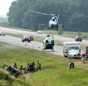 A second medical helicopter arrives at the crash scene near Ohio Turnpike mile marker 30, on the eastbound side. The crash was west of the Co. Rd. 17-3 overpass.