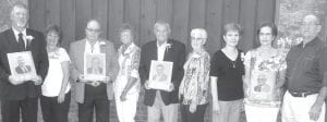 New inductees of the Fulton County Agriculture Hall of Fame are, from left: William Shininger and wife Cindy; Maurice Jones and wife Velma; Harold Holland and wife Sue; Jeanine Pursel, Suzanne Belter, and Gary Graber, children of Lloyd Graber.– photo by David Pugh