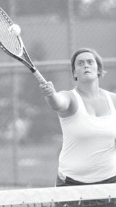 Lydia Andres returns a forehand at the net.– photo by Mary Huber