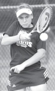 Emily Rose concentrates on returning the serve.– photo by Mary Huber