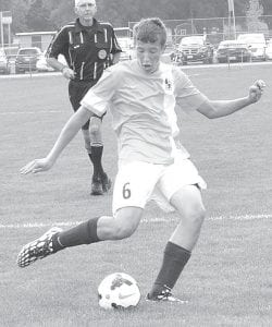 Archbold's Jereme Rupp gets ready to pass to a teammate in the Blue Streaks' match at Pettisville, Saturday, Aug. 23. The game ended in a scoreless tie.– photo by Mario Gomez