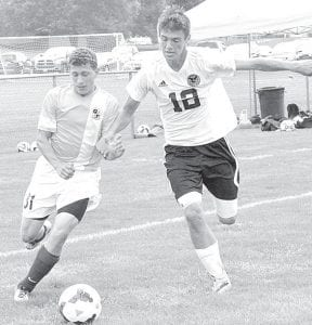 Archbold's Kegan Ott, left, and Pettisville's Ethan Brakefield race to the ball in their soccer match, Saturday, Aug. 23, at Pettisville.– photo by Mario Gomez