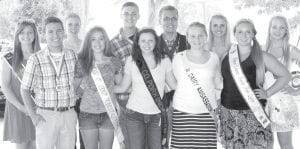 The Fulton County Junior Fair crowns a number of kings, queens, and ambassadors. Front row, from left: Payton Miller, caprine king; Taylor West, beef queen; Jolyssa Tedrow, pork industry queen; Courtney Krieger, dairy ambassador; Kaitlin Ruetz, junior fair queen. Back row: Kallie Strauss, first runner-up, junior fair queen; Mary Miller, puppy princess; Connor Ruetz, junior fair king; Sean Baker, 4-H king; Bailey Double, lamb & wool queen; Sarah Simon, 4-H queen. Missing: Nathaniel Ballmer, rabbit king; Hannah Stintson, rabbit queen; Lauren Smith, caprine queen; Adrianna Hibbard, horse queen.– photo by Mary Huber