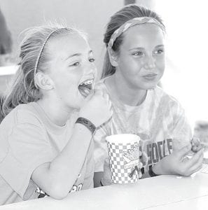 Emily Hines, 11, and Mikayla Welch, 12, Archbold, enjoyed the food at the fair.–photo by David Pugh