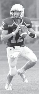 Blue Streak quarterback Derek Walker, shown against Delta, ran for two of Archbold's three touchdowns at Bryan last week.– photo by Mario Gomez