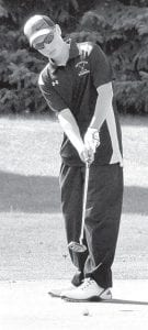 Pettisville's Andrew Canada watches his putt roll toward the cup.– photo by Mario Gomez