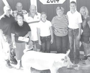 Grand champion market hog exhibitor Payton Moyer, son of Andrew & Jacqueline, Archbold. Buyers: Tom & Jane Moyer and Dail & Ellen Stutzman. From left: Andrew Moyer, Ellen & Dail (rear) Stutzman, Tom Moyer, Addison Moyer, Jane Moyer, Payton Moyer, Jacki Moyer.