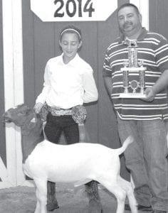 Grand champion market borer goat exhibitor Trinity Martinez, daughter of Jen & Rob Johnson, Metamora, and J.D. Martinez, Wauseon. Buyer: Falor Farm Center, repressented by Troy Najarian.
