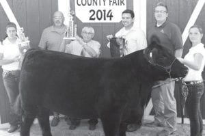Grand champion born & raised steer exhibitor Samantha Norman (not pictured), daughter of Roy & Anna, Wauseon (Christina Norman holding steer, Lynnsey Crouch holding trophy, far left). Buyers, from left: Tri-Flo, represented by Terry Rufenacht; Paul Barnaby; Robert McColley for State Rep., represented by Robert McColley; First Federal-Wauseon, represented by AJ Genter. Not pictured: Sandy Barber, Fulton County recorder; Brett Kolb; AMRI of Swanton & Napoleon; Vaughn Insurance Extreme Cattle; Fulton County Processing; State Rep. Barbara Sears; and Senator Clif Hite.
