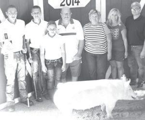 Reserve champion market hog exhibitor Garrett Cass, son of Dave & Krissy, Delta. Buyers: Genetic Edge/Tom Moyer family. From left: Garrett Cass, Payton Moyer, Addison Moyer, Tom & Jane Moyer, Jacki & Andrew Moyer.