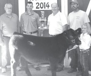 Grand champion beef feeder calf exhibitor Demi Powers (not pictured), daughter of Ryan and Amy, Fayette (Nevaeh Powers holding calf). Buyers: Davis & Kris Powers, represnted by Davis Powers; Farm Credit Mid- America, represented by Mike Evans; Poet Biorefining, Leipsic, represented by Mike Kneven; and Fulton County Cattle Feeders, represented by Mark Stuckey.