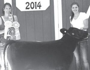 Reserve champion beef feeder calf exhibitor Rylee Ruger, daughter of Steve & Julie, Fayette (Julie Ruger holding trophy/ribbons). Buyer: Turbine Standard.