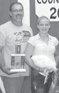 Grand champion market pen of three chickens exhibitor Peyton Dickman, daughter of Norm & Lisa, Fayette. Buyer: McDonnall Harvester & Parts, Inc., represented by Ben Puehler.