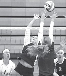 Left: Pettisville's Jordyn Pursel, second from left, tries to tip the ball over the outstretched hands of Archbold's Macey Rupp in their second match of the Streak Spike-Tacular, Saturday,