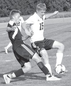 Pettisville's Gabe Beck (15) battles for the ball with a Liberty Center Tiger, Thursday, Sept. 18.– photo by Mario Gomez