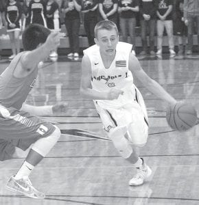 Eli Miller brings the ball down the court for the Blue Streaks.– photo by Scott Schultz