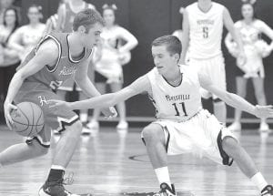 Justin Rupp (11) goes for the steal against Hilltop, Friday, Jan. 29.– photo by Mario Gomez