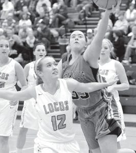 Pettisville's Lynnsey Crouch (33) drives hard to the basket against Montpelier, Tuesday, Jan. 19.– photo by Mario Gomez