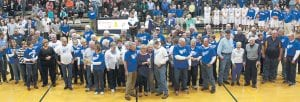 Ridgeville Falcon Night, Friday, Feb. 5, at Archbold High School, was, by any standard, a big success. The Ridgeville School District was consolidated into three districts in 1969; one was Archbold. Top: RHS alumni and former members of the faculty and staff sing the Ridgeville alma mater and a fight song on the gym floor. Lower left: Members of the Ridgeville School District staff in attendance and recognized between the JV and varsity boys basketball games, from left: Tom Vershum, who taught at Ridgeville for one year before taking a position with Archbold schools; Phyllis Hesterman, a teacher at Ridgeville before joining the Archbold staff; Larry Sinclair, a teacher; Ed Haughan, a teacher and coach at Ridgeville and then other districts in Ohio and Michigan; and Lillian VonDeylen. She and her husband were longtime custodians at the School. Lower right: Darlene (Helmke) Myers, RHS '53, left, and her sister, Mary Ellen (Helmke) Fedderke, RHS '55, look at some of the Ridgeville memorabilia on display. The sisters both reside in Ridgeville Corners.– photos by Mary Huber and David Pugh