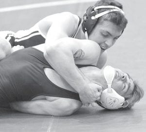 Noah Mattin works for a pin of Montpelier's Logan Hutchinson in the NWOAL championship semifinals, Saturday, Feb. 6.– photo by Mario Gomez