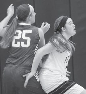 Pettisville's Lynnsey Crouch, right, plays defense on Stryker's Haley Doehrmann in their BBC battle, Thursday, Feb. 4.– photo by Mary Huber