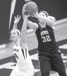 Archbold's Cassi Wyse, left, knocks the ball out of the hands of OG's Kylie White in the third quarter of the battle of the two state-ranked teams, Tuesday, Feb. 9. The Titans prevailed 60- 52.– photo by Mary Huber