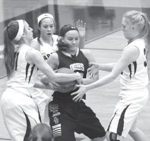 Alyssa Ziegler and OG's Mackenzie Meyer fight for possession of the ball. Also in on the play are Kamryn Hostetler and Morgan Miller.– photo by Mary Huber