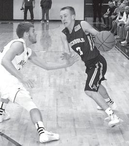 Eli Miller attempts to penetrate inside against Napoleon. The sophomore scored 13 points in Archbold's 63-57 non-league loss.– photo by Scott Schultz