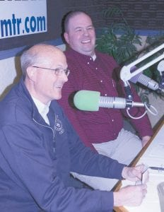 Andy Brodbeck, Archbold fire chief, left, and Rick Sluder, Wauseon fire chief, enjoy a laugh during the Fulton County Heart Radiothon, Thursday, Feb. 11. Law enforcement officers, business leaders, school officials, and listeners dedicate songs over the air for pledges during the event.– photo by David Pugh