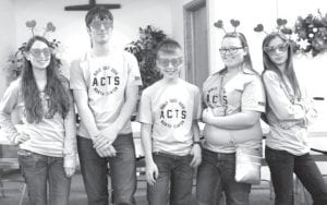 """Dressed up for Bible Quiz Spirit Week, """"Hearts of Faith"""" members quizzed their hearts out to win four matches and average 105 points in their six matches at the Sunday, Feb. 21 quiz meet. Passing out heart rings and candy throughout the day, the team was recognized for acting out their team name. From left: Cara Foor, who averages 35 points and has quizzed out in all 19 of her matches, with teammates Derek Aeschliman, Logan Richer, Mindy O'Neill and Hannah Richer, who averages 30 points per match.– courtesy photo"""