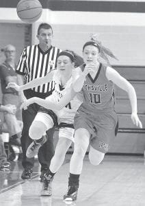 Pettisville's Morgan Leppelmeier, left, races Hicksville's Katelynn Berenyi to the ball in their Div. IV sectional semifinal, Wednesday, Feb. 17.– photo by Mario Gome z