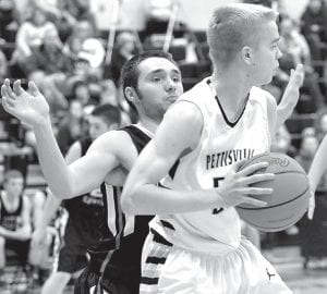 Landon Roth tries to shake off a North Central Eagle in their BBC contest, Friday, Feb. 19.– photo by Mario Gomez