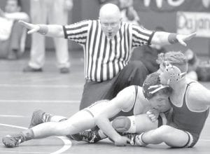 Noah Mattin appears to have control for a takedown against Sandusky St. Mary Central Catholic's Dominic Rosin, but the referee thinks otherwise. Mattin won a 7-2 decision in the match. The AHS junior finished third.– photo by Mario Gomez