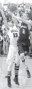Elmwood's Nate Uzelac blocks Bryce Williams' pass under the basket.– photo by Scott Schultz