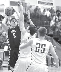 Gabe Beck (5) eyes the basket as he gets pressure defensively from Fayette's Jerad Seiler.– photo by Mario Gomez