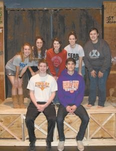 """Some cast members of the coming Pettisville High School production of """"South Pacific,"""" on the back stage set of the Follies, a show within a show. Seated, from left: Gabe Beck, Andrew Sauder. Standing: Hannah Herring, Mallory Riegsecker, Elizabeth Miller, Amber Klopfenstein, Abbigale Nagel. """"South Pacific"""" opens Thursday, March 10, in the PHS auditorium.– photo by David Pugh"""