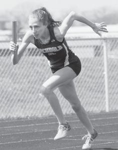 Julia Lambert was the leadoff runner on the 4x100, 4x200, and 4x400 relay teams that placed first at the Napoleon Early Bird Invitational, Saturday, March 26.– photo by Dennis Driver