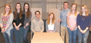"""Cast members of """"The Little Mermaid,"""" the AHS spring musical, gather on stage. From left: Marin Parsley, Malinda Lugbill, Ellie Rupp, Adam Grisier, Allie McQuade, Will Collins, Emilee Piorkowski, and Lindsey Roehrig. The students talked about the challenges of their roles, and the differences between a movie and a musical.– photo by David Pugh"""