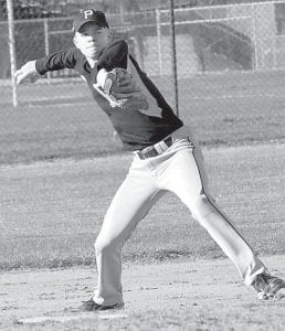 Landon Roth fields a grounder and throws to first base for an out against Wauseon, Tuesday, March 29.– photo by Mario Gomez
