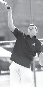 Left: Lucas Rupp serves the ball in number one doubles action against Bowling Green, Tuesday, April 5. Rupp and Alex Short split their pair of matches last week. Right: Jereme Rupp attacks the net. He won both matches last week.– photos by Mary Huber