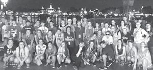 Members of the Archbold High School Marching Band take time out for a picture while waiting for the fireworks to start on the night of their first day at Walt Disney World. The trip to Florida, held over spring break, included fun and educational activities.– courtesy photo