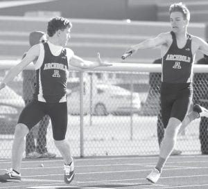 Kegan Ott takes the handoff from Noah Blankenship in the boys 4x200, Tuesday, April 12. The Blue Streak boys won three of the four relays at the NWOAL tri-meet with Evergreen and Patrick Henry.– photo by Dennis Driver