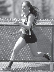 Delanie Driver runs the first leg of the girls 4x100.– photos by Dennis Driver