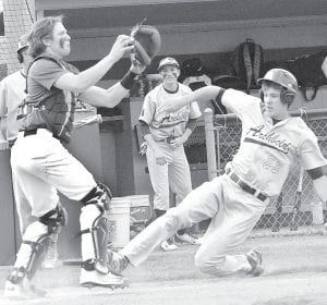 Seth Mayer slides but is unable to beat the throw home against Swanton, Monday, April 25.– photo by Mario Gomez