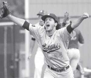 Pitcher Lathon Babcock celebrates after throwing a four-hit shutout to defeat Tinora 2-0 in the district championship game, Saturday, May 21.– photo by Mary Huber